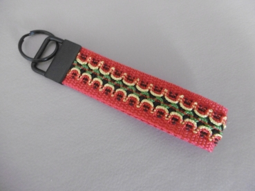 Key chain with decorative ribbon and black metal clasp